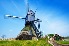 Old rotating water pumping windmill in Holland Stock Photos
