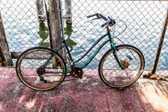 Old rotten bike at a rusty fence Royalty Free Stock Photos