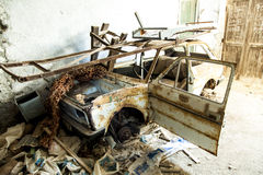 Old  rotten car in  factory Stock Photo