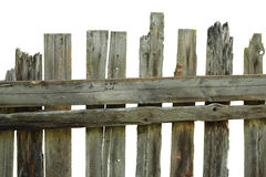 Old rotten fence of pine boards. On a white background Stock Photography
