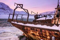 Old rotten fish boat in Teriberka, Murmansk Region, Russia stock images