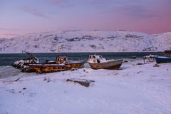 Old rotten fish boats in Teriberka, Murmansk Region, Russia Stock Image