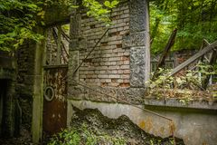 Old Rotten House left to decay in the woods stock photos
