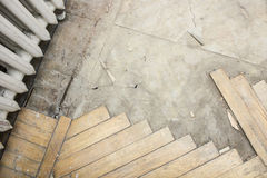 Old rotten parquet flooring removed. Old rotten parquet floor is partially dismantled Stock Image