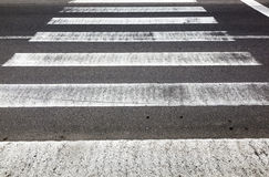 Old rotten pedestrian crossing stripes Royalty Free Stock Photos