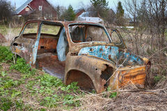 The old, rotten, rusty destroyed car Stock Images