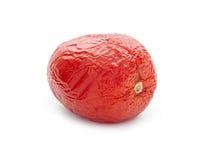 Rotten tomato. Old rotten tomato isolated on white background Stock Photos