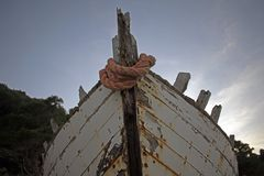 Old rotten wooden ship with paint peeling off stock photography