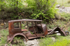 An old rotting vehicle in the desert Royalty Free Stock Photography
