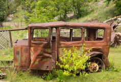 An old rotting vehicle in the desert Royalty Free Stock Image