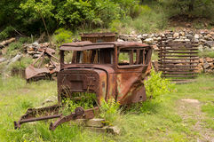 An old rotting vehicle in the desert Stock Photo