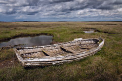 Old rotting wooden stranded rowing boat Royalty Free Stock Image