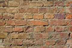 Old rough brown bricks wall texture background royalty free stock images