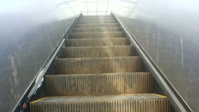 Old rough escalator moving up, full hd video. Old escalator moving up with the real camera movement live stock video footage