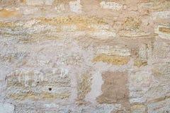 Old rough grey stone wall texture Stock Photos