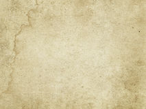 Old rough paper texture. Rough aged and yellowed paper background or texture for the design. Grunge paper stock photos