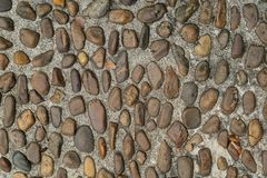 Pebble or gravel stone texture floor background. Old rough random pebble or gravel stone texture floor background.have some space for write wording royalty free stock photography