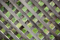 Old rough rhomb shaped fence. Royalty Free Stock Image