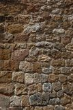 Old rough stone wall  background Stock Photo