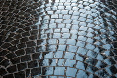 Old Rough texture of wet stones pavement.  Stock Photography
