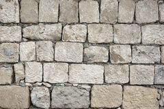 Old Rough Uneven Bumpy  White Stonewall Background Royalty Free Stock Photo