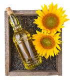 Old rough wooden box with sunflowers, oil bottle Stock Images