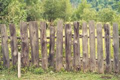 Wooden fence. Old rough wooden fence in the village stock images