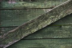 Old rough wooden surface painted in green color - rustic style royalty free stock photos