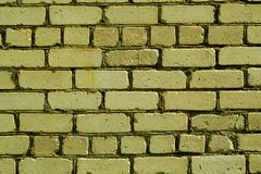 Old rough yellow color brick wall pattern. Royalty Free Stock Photo