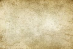 Old rough and yellowed paper texture. Aged dirty and yellowed paper texture for background Stock Image