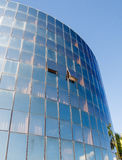 Open Windows in Round Blue Glass Building Stock Images