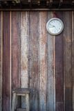 Old round clock hang on old wooden wall Royalty Free Stock Photos