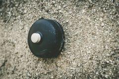 Old round doorbell Stock Image