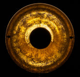 Old round gold object Royalty Free Stock Image