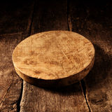 Old round rustic wooden cheese board Royalty Free Stock Photography