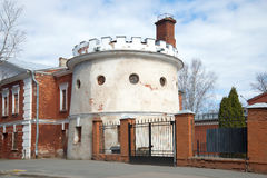 Old round tower cloud March afternoon. A fragment of the fortifications of Kronstadt. Russia. Old round tower cloud March afternoon. A fragment of the Royalty Free Stock Images