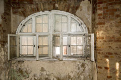 Old round window on a brick wall Stock Images