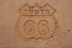 Old Route 66 sign in concrete Royalty Free Stock Photos