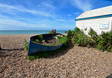Old row boat on Brighton beach Stock Images