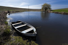 Free Old Row Boat In A Small Pond. Royalty Free Stock Photo - 90750665