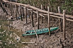 Old row boat in the mud Royalty Free Stock Photos