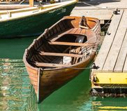 Old Row Boat Tied to Dock. On sunny afternoon Stock Image