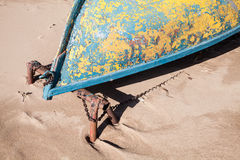 Old rowboat lays on sandy beach, bow fragment Royalty Free Stock Photo
