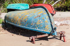 Old rowboats lay on sandy coast. Gulf of Finland Royalty Free Stock Photos