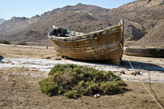 Old rowing boat. Old wooden fishing boat on the coast Stock Photos