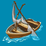Old rowing boat with dilapidated sailboat on water Royalty Free Stock Photography