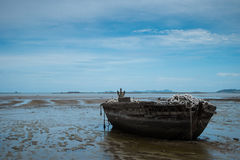 An old rowing boat in need of repair on the beach Royalty Free Stock Photography