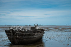 An old rowing boat in need of repair on the beach Royalty Free Stock Photos