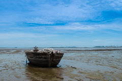 An old rowing boat in need of repair on the beach.  Stock Photos