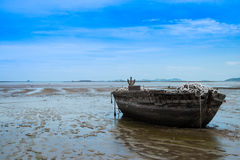 An old rowing boat in need of repair on the beach.  Stock Photography